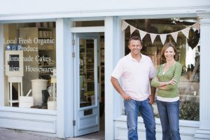 Blog: friendly couple in front of shop